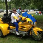 Merle Reeseman on yellow motorbike