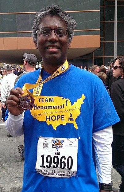 Peter Kochupura with a race medal