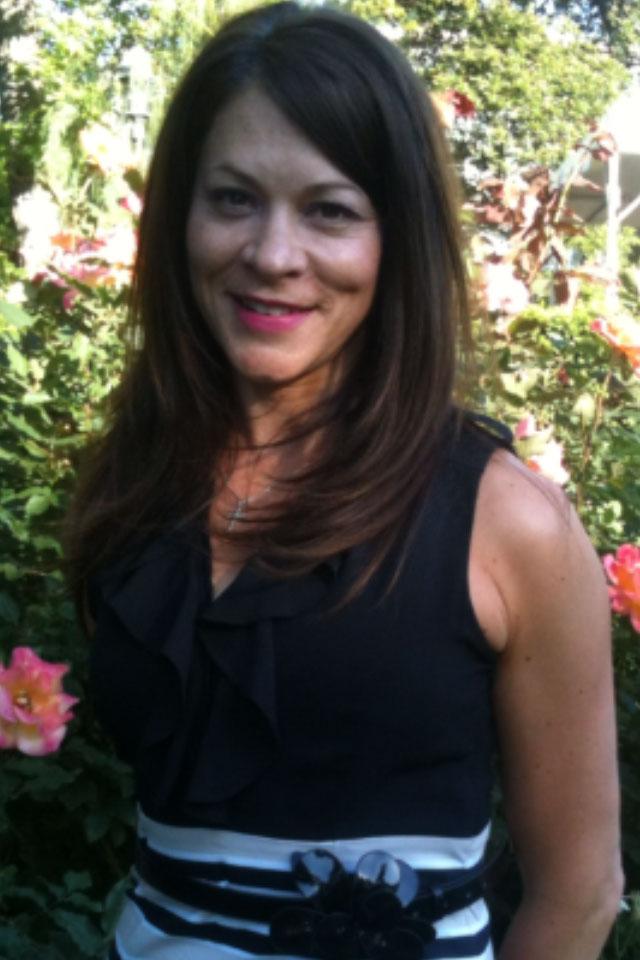 Monica-Reisz-with-flowers