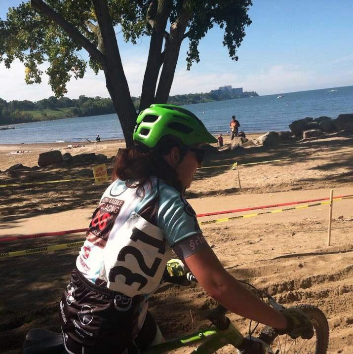Sara Harper cycling on a beach