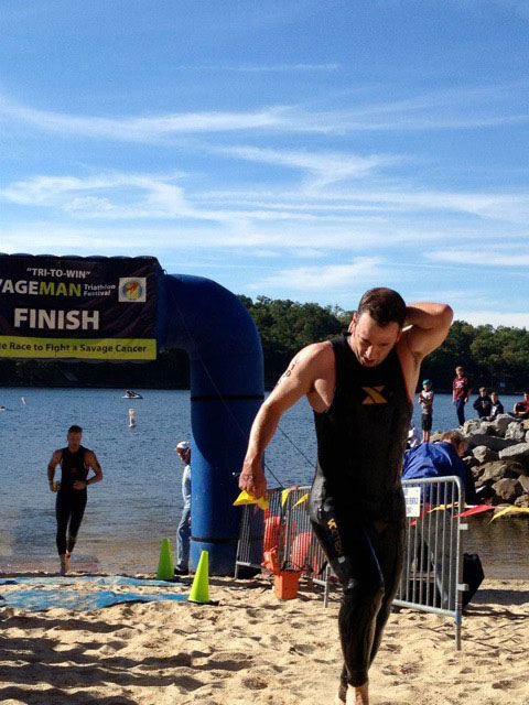 Timothy Bachman exiting lake after a swim event
