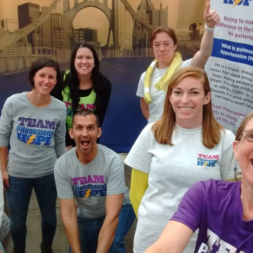 Members and volunteers with Team PHenomenal Hope at the Marathon Exp