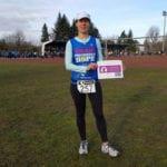 Katrin Hetebruegge holding a LetMeBeYourLungs sign before her race for Monika Kischel